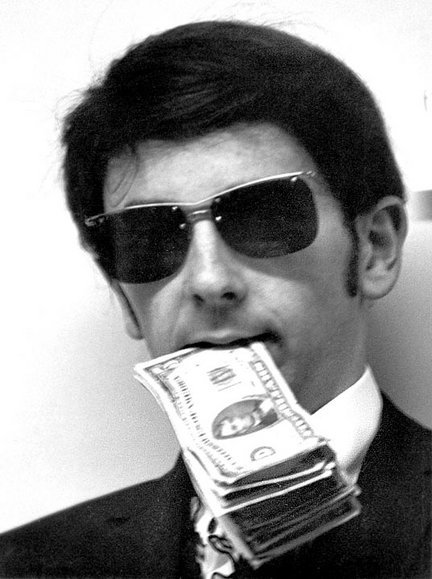 phil spector with dollars