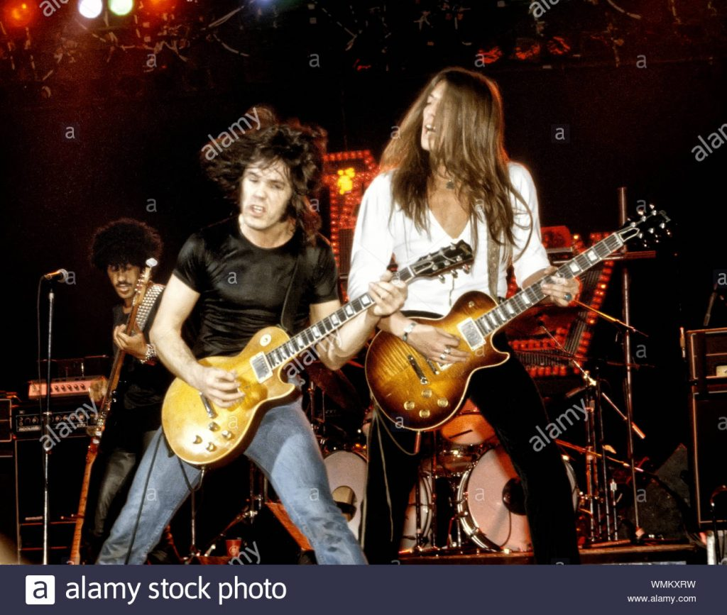 thin lizzy phil-lynott-gary-moore-and-scott-gorham-of-thin-lizzy-onstage-at-the-palladium-in-nyc-in-september-1978-WMKXRW